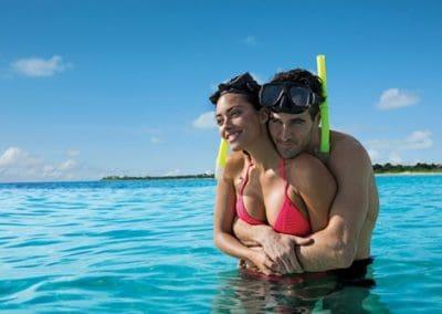 secrets-akumal-deal_ext_honeymooners_snorkeling2_4a